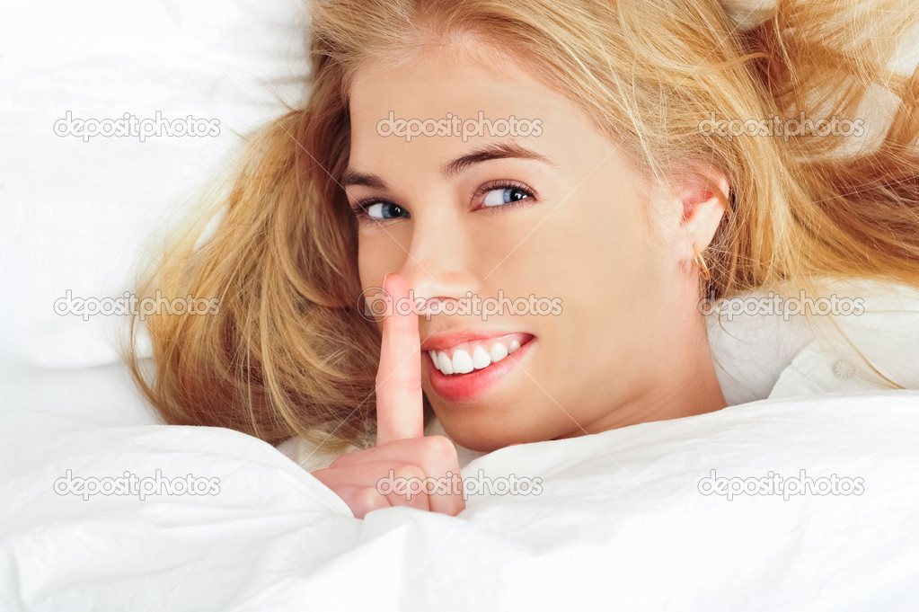 Beautiful young blond woman on the bed at home — Stock Photo #5866581