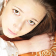 Closeup portrait of young pretty girl laying on her bed — Stock Photo