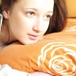 Stock Photo: Closeup portrait of young pretty girl laying on her bed