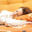 Closeup portrait of young pretty girl laying on her bed — Stock Photo #5911608