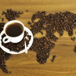 Dramatic photo of world map made of coffee beans. - Photo