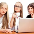 Group of women with a laptop computer - isolated - Stock Photo