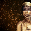 Portrait of young dancing girl with golden body art — Foto de Stock