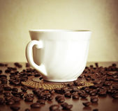 Warm cup of coffee on brown background — Stock Photo