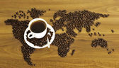 Dramatic photo of world map made of coffee beans. — Stock Photo
