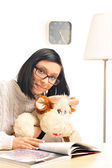Closeup portrait of a young woman embracing her soft toy — Stock Photo