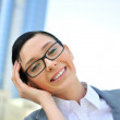 Closeup portrait of cute young business woman smiling — Stock Photo