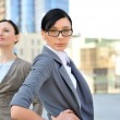 Portrait of a beautiful business woman with a female colleague — Stock Photo