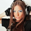 Club style woman with headphones listening to music looking at c — Stock Photo #5969356