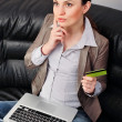 Portrait of beautiful business woman with laptop and credit card - Stock Photo
