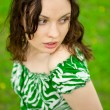 Closeup portrait of young beautiful woman wearing green dress si - Stock Photo