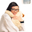 Stock Photo: Closeup portrait of young womembracing her soft toy