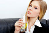 Closeup portrait of young business woman drinking water with nat — Stock Photo