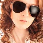 Closeup portrait of beautiful fashion woman wearing sunglasses o — Stock Photo