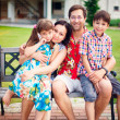 Stock Photo: Artistic lifestyle photo of happy family having fun outdoors at