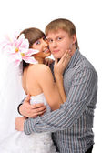 Closeup portrait of young caucasian bride and groom against whit — Stock Photo