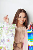 Closeup portrait of happy woman with shopping bags leaning on wa — Stock Photo