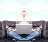Portrait of young business woman sitting with a laptop on comfor — Stock Photo