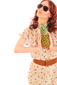 Closeup portrait of daydreaming woman holding pineapple fruit we — Stock Photo