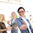 Business woman in a friendly environment of her colleagues — Stock Photo