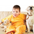Handsome Young Boy Playing with His Two Dogs Against White Backg — Stock Photo