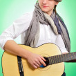 Closeup portrait of cute caucasian man playing the guitar over g — Stock Photo