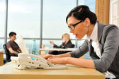 Closeup portrait of cute young business woman using laptop — Stock Photo