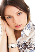 Beautiful European young woman standing with hands near cheek ag — Stock Photo