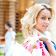 Happy shopping woman with bags — Stock Photo
