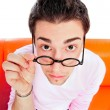 Stock Photo: View from above of man in glasses looking at camera with hands o