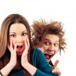 Stock Photo: Mad mwith funny hairdo tempting young girl for something