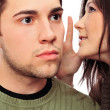 Closeup portrait of young couple of students. Woman whispering s — Stock Photo