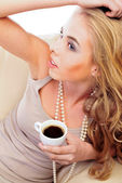 Morning coofee of a stylish woman — Stock Photo