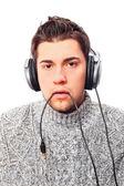 Closeup portrait of sad young man wearing domestic sweater holdi — Stock Photo