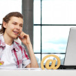 Royalty-Free Stock Photo: Portrait of handsome young man working with laptop on freelance