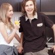 Playful young couple in their kitchen. — Stock Photo #6082673