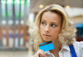 Beautiful shopping woman holding a credit card — Stock Photo