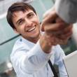 Royalty-Free Stock Photo: Closeup of business shaking hands over a deal at office -