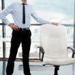 Portrait of confident businessman at his office standing near em — Stock Photo