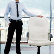 Portrait of confident businessman at his office standing near em — Stock Photo #6128129