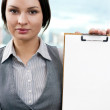Portrait of business woman holding blank reports and looking at - Stok fotoğraf