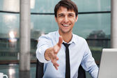 Happy mature business man offering a welcoming hand — Stock Photo