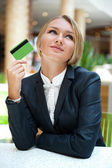 Closeup portrait of cute young business woman smiling while hold — Stock Photo