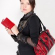 Portrait of a bright beautiful young woman with fashion handbag — Stock Photo