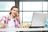 Portrait of handsome young man working with laptop on freelance — Stock Photo