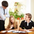 Stock Photo: Teacher helping students in school classroom. Horizontally frame
