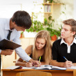 Teacher helping students in school classroom. Horizontally frame — Stock Photo #6302449