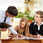 Teacher helping students in school classroom. Horizontally frame — Stock Photo