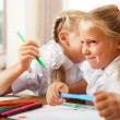 Two little girls gossip in classroom — Stock Photo #6302465