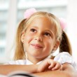 Portrait of a young girl in school at the desk. — Stock Photo #6330867